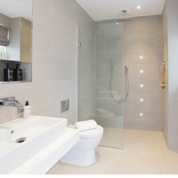 newly installed bathroom with walk in shower